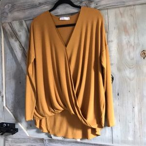 Long sleeved mustard draped top